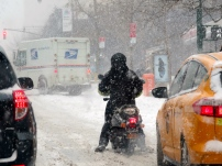 """Nothing stops restaurant delivery. This guy is """"lucky"""" to have a moped available, most are on bicycles."""